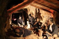 Inside the gold mine, workers are taking a rest.