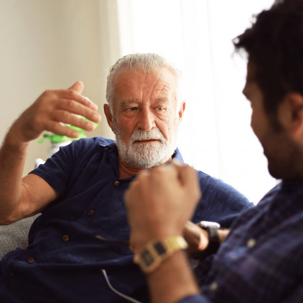 Older man discussing finances with his son
