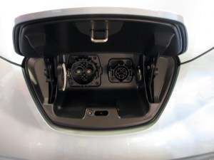 A close-up view of two different types of charging ports in an electric vehicle