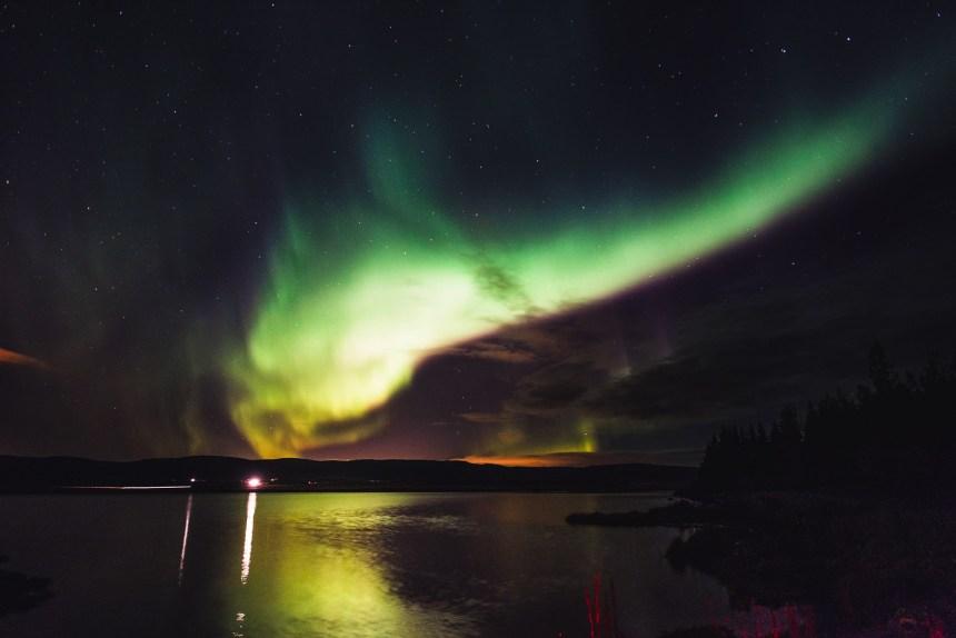Aurora Borealis Across Lake Iceland