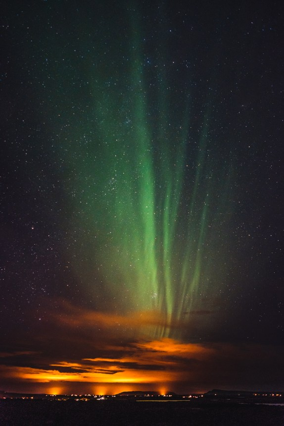 Aurora Borealis Steaky Over Light Pollution Iceland