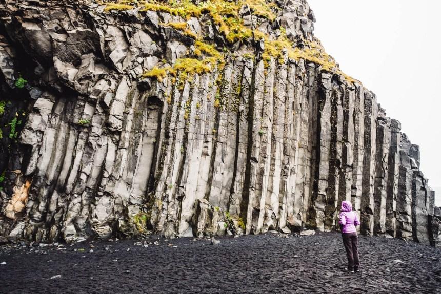 Iceland South Reynisfjara Beach Landscape Rock Columns Purple Coat