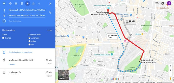 A screenshot from Google Maps showing walking directions between Prince Alfred Park Pool and the Powerhouse Museum near Central Station, Sydney. Google Maps walking directions suggest a long way around primarily using Cleveland Street, Regent Street and Harris Street. A much more direct and pedestrian friendly route using the Devonshire Street Tunnel and the Goods Line has been marked in Red.