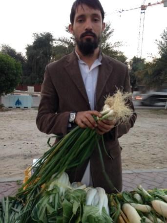Pakistani vendor selling spring oinons