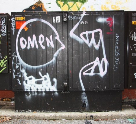 Omen drawing in alley off Fairmount