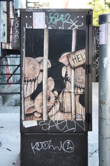 Kat poster in alley between St-Laurent and Clark