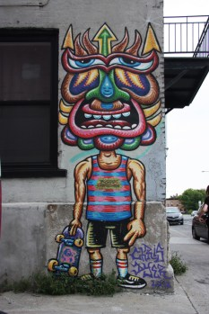 A Positive Creation by Chris Dyer in alley off Bellechasse
