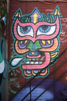 Piece by Chris Dyer aka Positive Creations on housefront on St-Dominique
