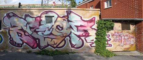 Graffiti by Unknown artist in alley between St-Dominique and Coloniale