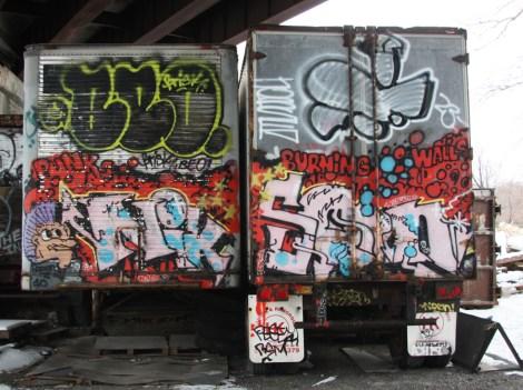 Nixon graffiti on backs of trucks parked near Bernard