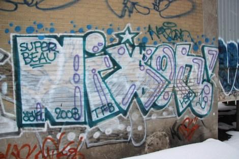 Graffiti piece by Nixon in the fashion district