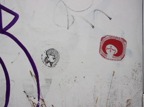 Paste-ups by Stela (left) and Swarm (right) in alley between St-Laurent and Clark