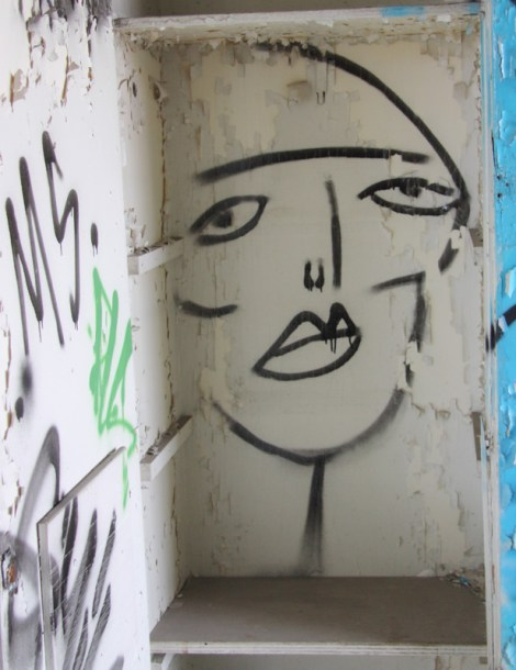 Figurative tag by Mono Sourcil inside abandoned building