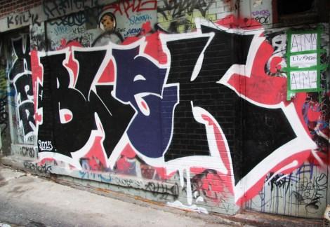Blek graffiti in alley between St-Laurent and Clark