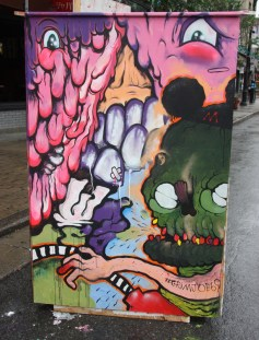 Grimjob69 on the back of an information panel for the 2015 edition of Mural Festival