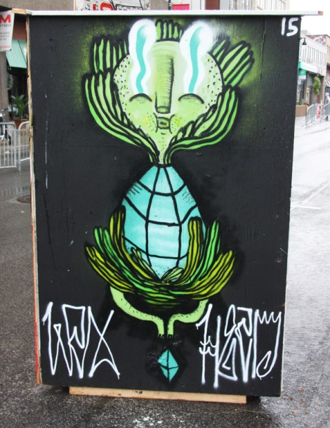 Waxhead on the back of an information panel for the 2015 edition of Mural Festival