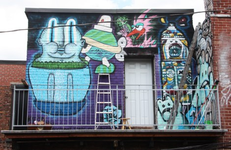 Collective work featuring Waxhead (left and bottom corner), Turtle Caps (above ladder), Futur Lasor Now (above door), Deadliest Rosa and El Moot Moot (right wall)