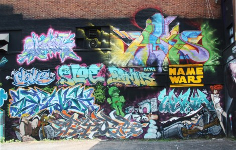 Wall produced during the 2015 edition of the Under Pressure Festival featuring Minus (top left), Haks (top right), Dove (middle left), Sloe (middle), Ganjus (middle), Strike and Wuna (bottom)