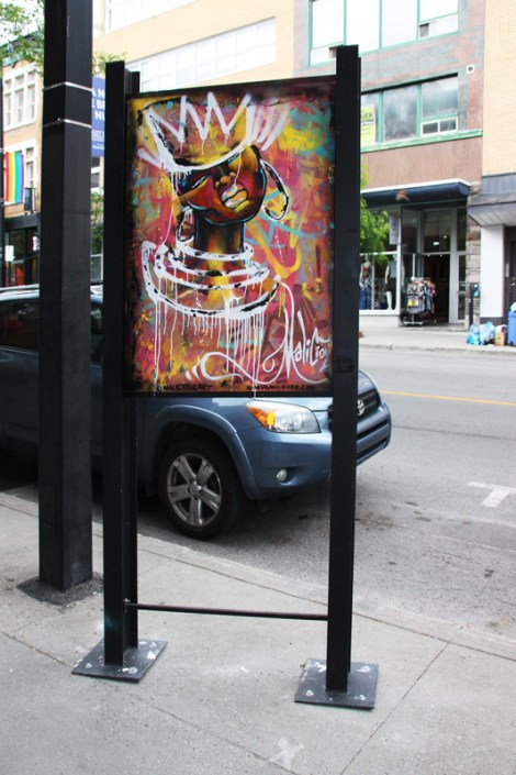 Maliciouz on sidewalk panel on Amherst for the 2016 edition of the MTL En Arts festival