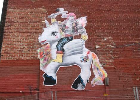 Big Stikki Peaches wheatpaste in the Mural Festival zone