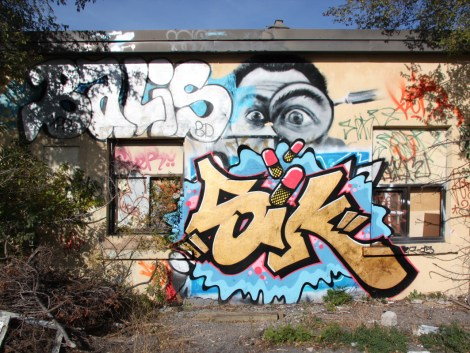 "Tuna representing the SIK crew (ground level), Balis (top left) outside the abandoned ""Jailspot"""