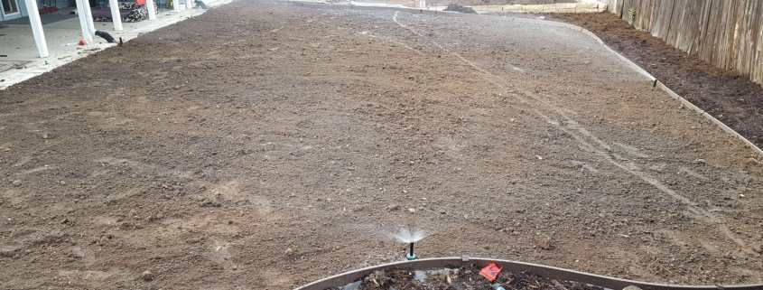 The sprinklers running after seeding the yard.