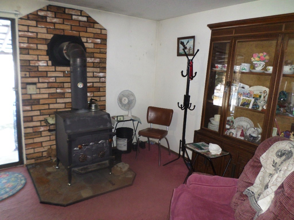 The dining room off the kitchen has a warm wood stove