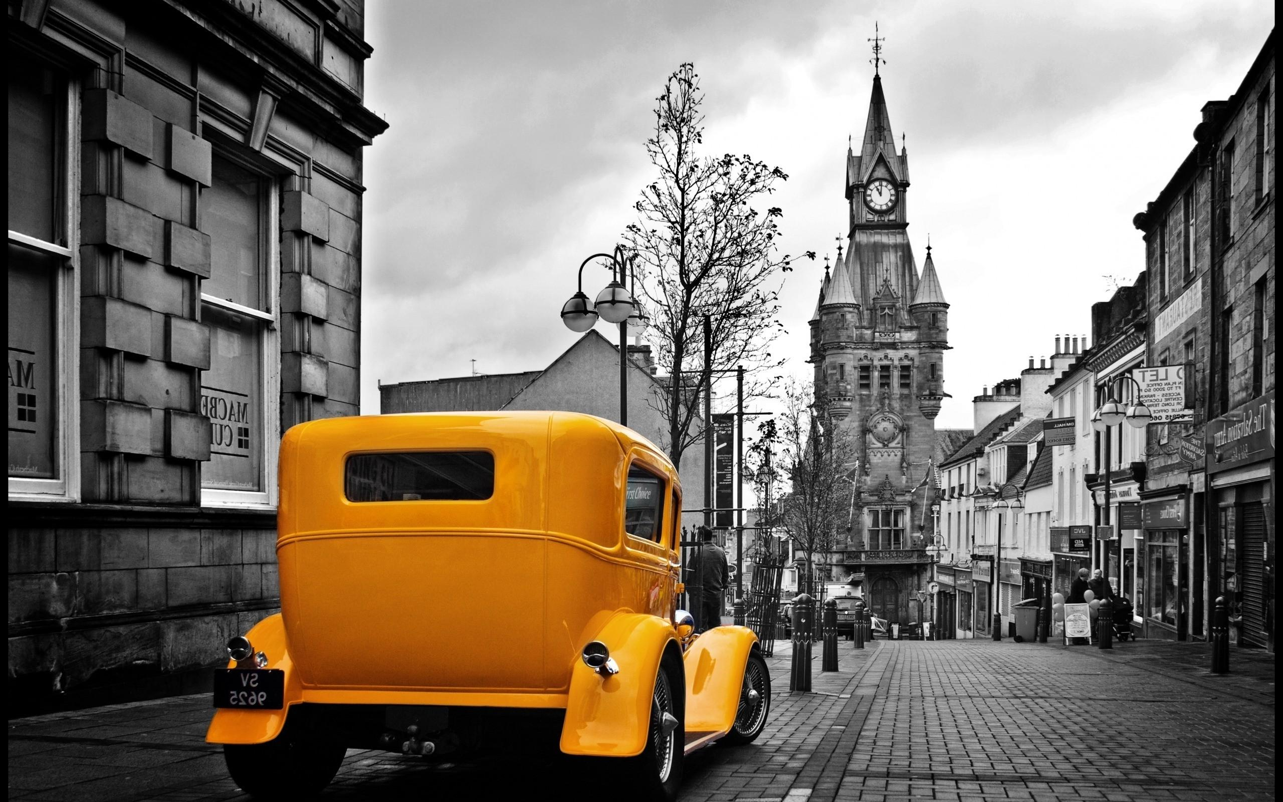 vintage yellow car in a gray city wallpapers hd / desktop and
