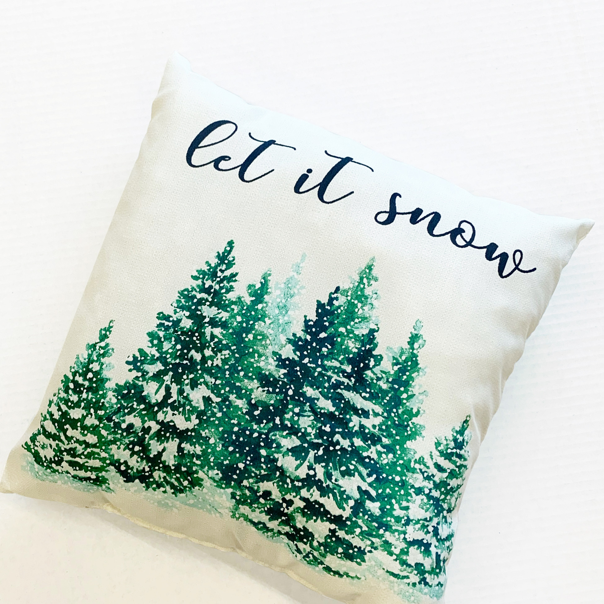 """white """"let it snow"""" pillow with pines"""