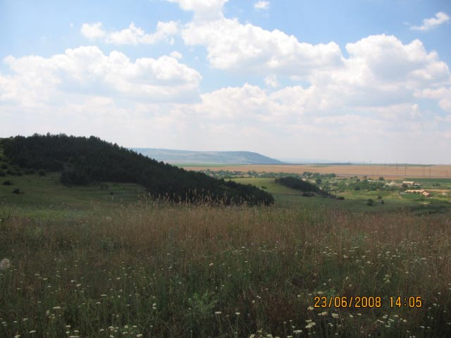 Needs some descriptive text to describe what the picture is of or what it is about. Example: This beautiful view shows Madara mountains to the west which is the main view that Walnut Grove, Zaychino Oreshe residents will see from their new 4 bed detached houses. Note that the mountain below shows the proposed golf course site on a plateau and the housing development is below this- bordering a small forest.