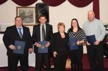 Left-to-right: Capt. Steve Doe, Capt. Ed Millian, City Council President Diane LeBlanc, Julie Pelletier (dispatcher) , Lt. Lenny Comeau.