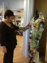 Shula admiring Yolanda Celucci's over-the-top dress
