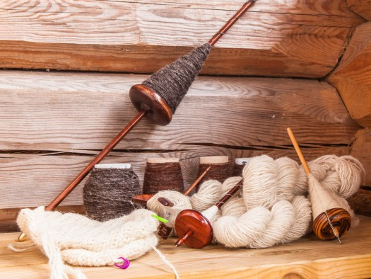 Several skeins and full spindles.