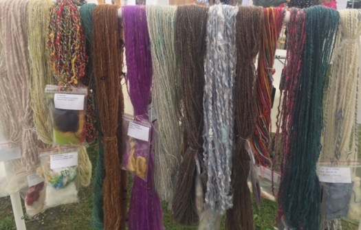 A row of art yarns in different colours and styles