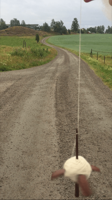 A Turkish spindle with a country road in the background.