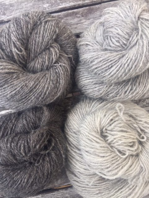 Four skeins of grey handspun yarn
