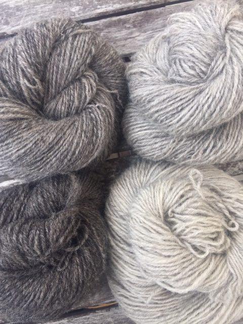 Four skeins of grey handspun yarn