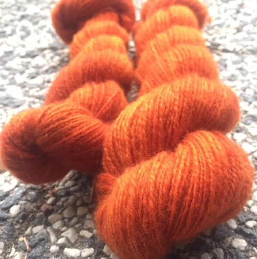 Two skeins of handspun orange yarn
