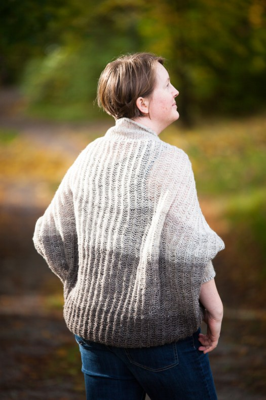 Josefin Waltin wearing a grey slouchy shrug made of handspun yarn