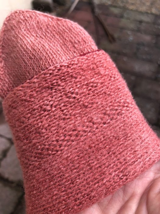 A pink mitten turned inside-out