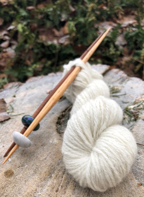 A 3-ply yarn and two medieval style spindles