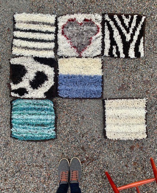 Seven woven squares with rya knots. They are in different patterns and colours – striped, plain, zebra skin, cow skin and a heart.
