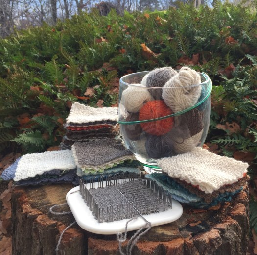 Woven squares in piles on a tree trunk. Balls of coloured yarn in a glass bowl.