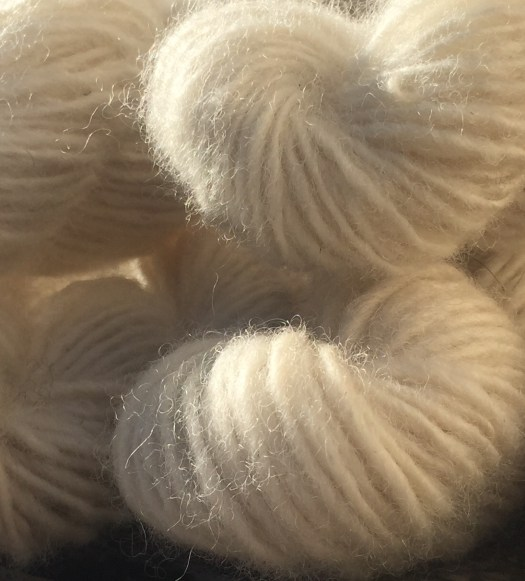 Close-up of natural white skeins of bulky singles.