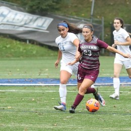 Alondra Cervantes dribbles the ball away from a Cabrini defender to prevent a Cavalier score in the 2017 battle of Eagle Road.