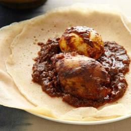 Doro Wat on Injera is a traditional holiday meal typically served in Ethiopia