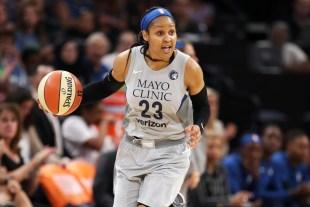 Maya Moore playing basketball for the WNBA.