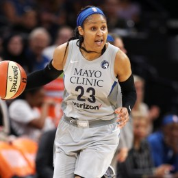 Maya Moore playing basketball for the WNBA.