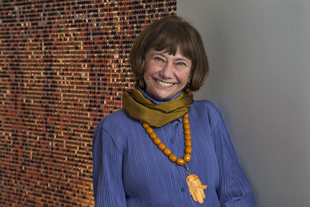 (1981 - 2020) Weisman Director and Chief Curator Lyndel King is pictured in a blue shirt, scarf and statement necklace at the museum