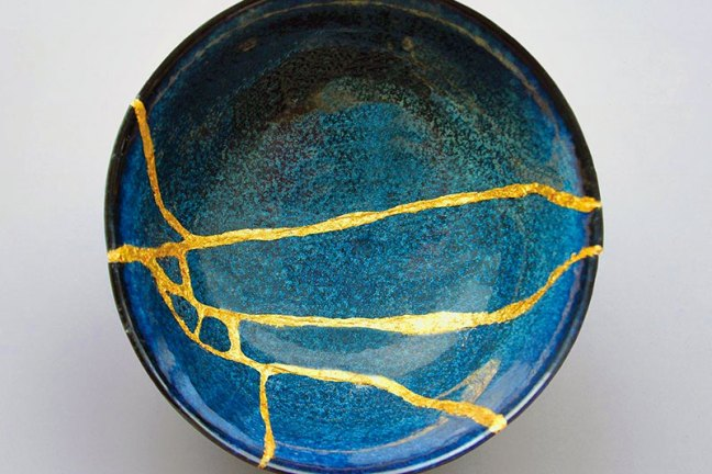 Blue ceramic plate, broken, but fixed with gold ceremic glue via the Japanese method Kintsugi.